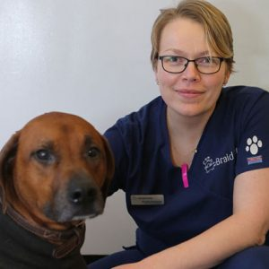 Vet Smiling with Dog