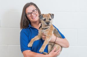 Tracey Murray holding Border Terrier Dog