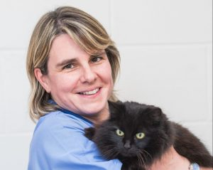 Fiona Kennedy Anaesthesia Assistant and Practice Administrator at Border Vets in Selkirk holding black cat